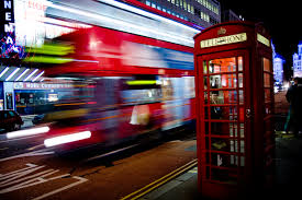 Bus blurred by motion.