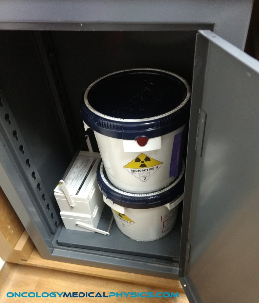 An Ir-192 source arrives in a shielded bucket.