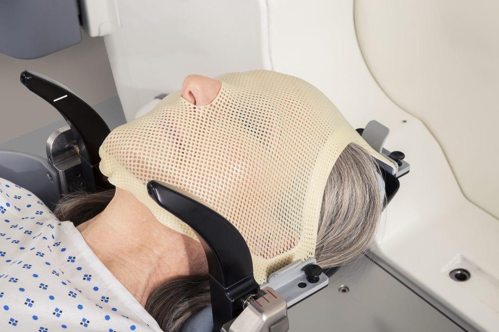 Frameless SRS mask, black arms hold reflectors for fiducial tracking. Image credit: Elekta
